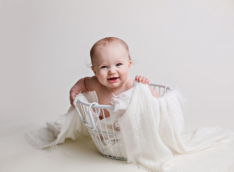 happy six month old photography portraits meridian mississippi