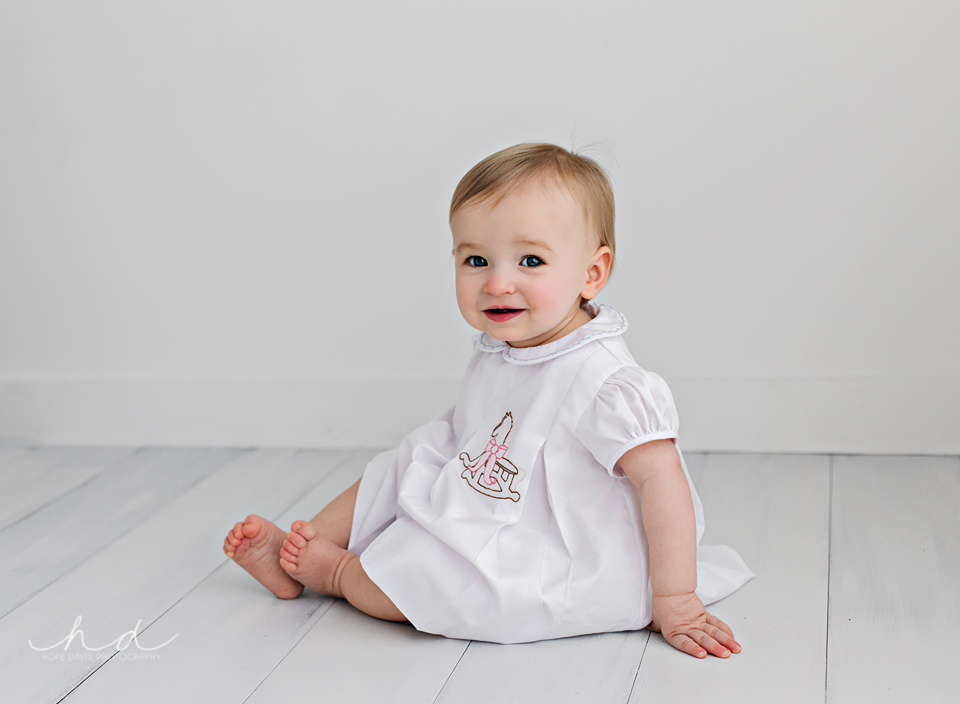 simple white one year old photo shoot