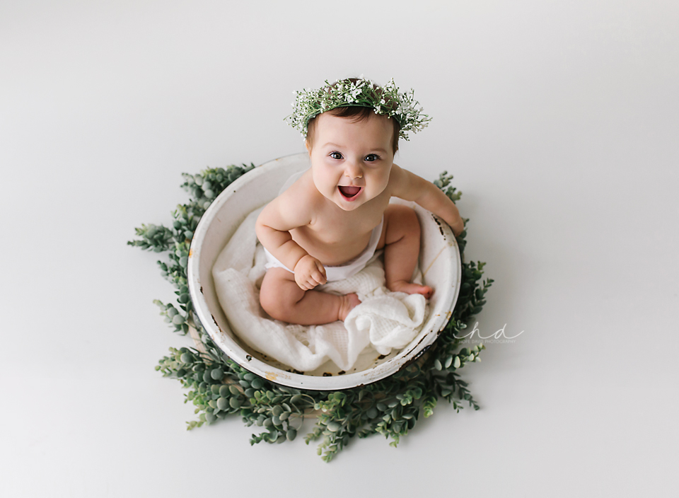6 month old baby in washtub with floral crown