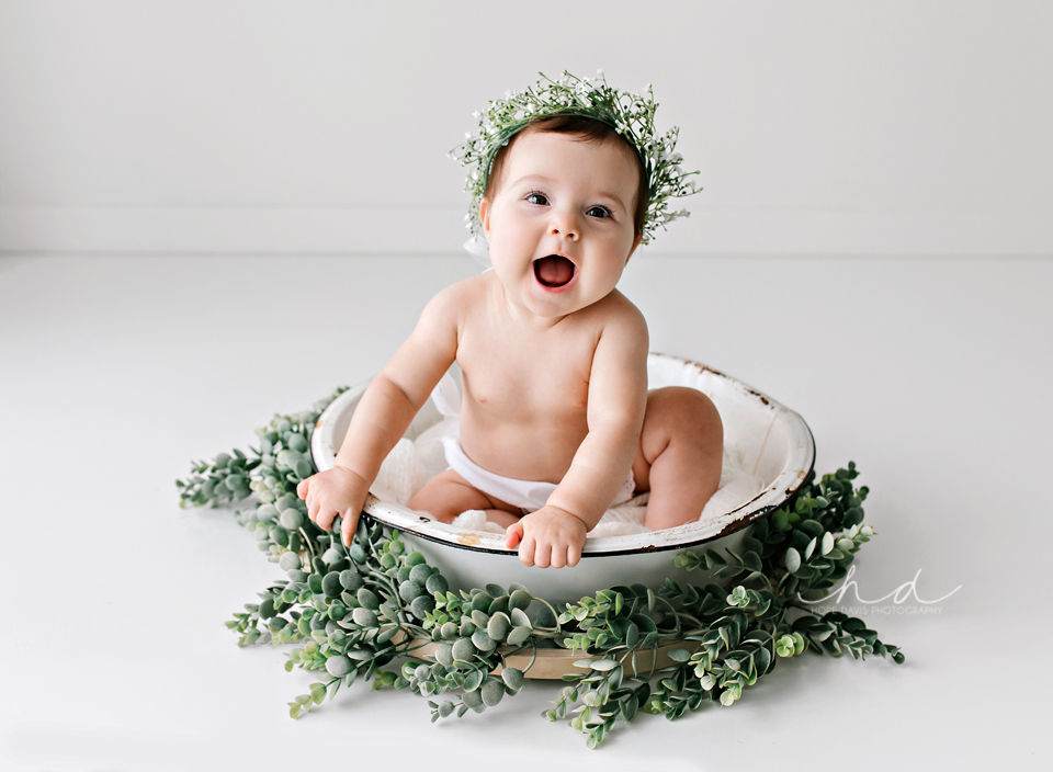 6 month old baby girl in washtub with floral crown white background