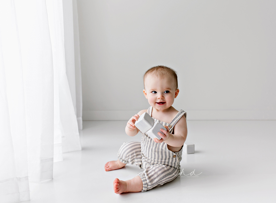 one year old boy playing with blocks photo shoot