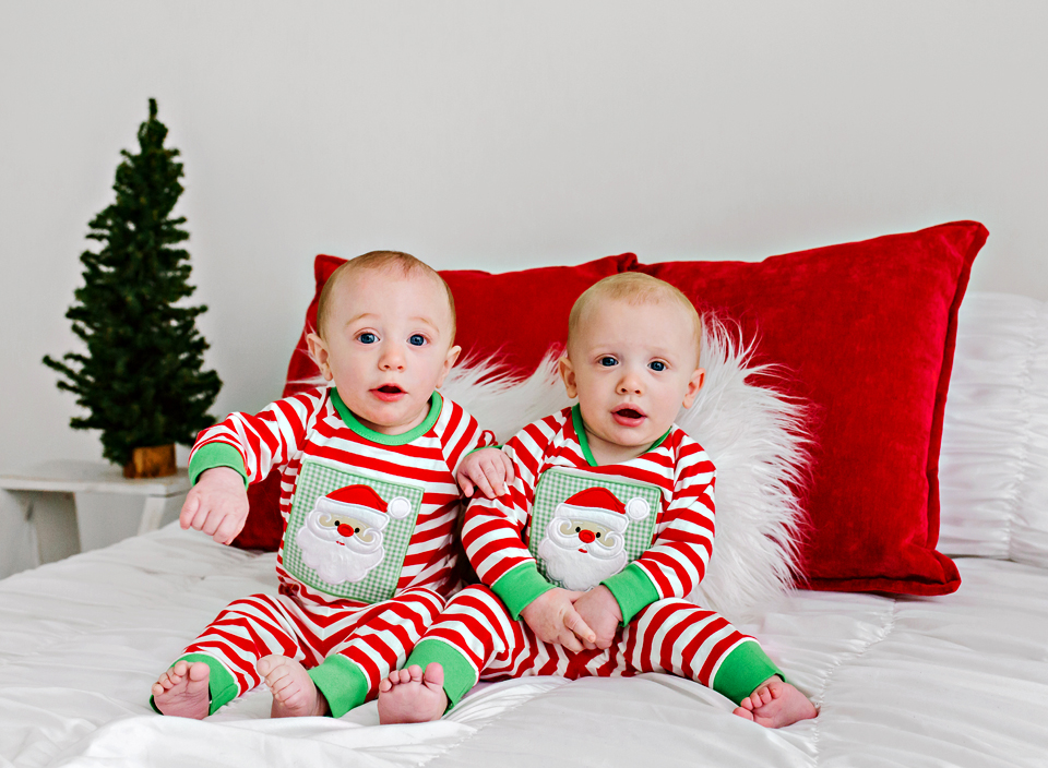 Christmas mini session with 6 month old boy twins in Christmas jammies