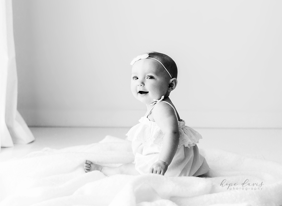 brandon ms baby photos baby girl sitting on blanket black and white picture