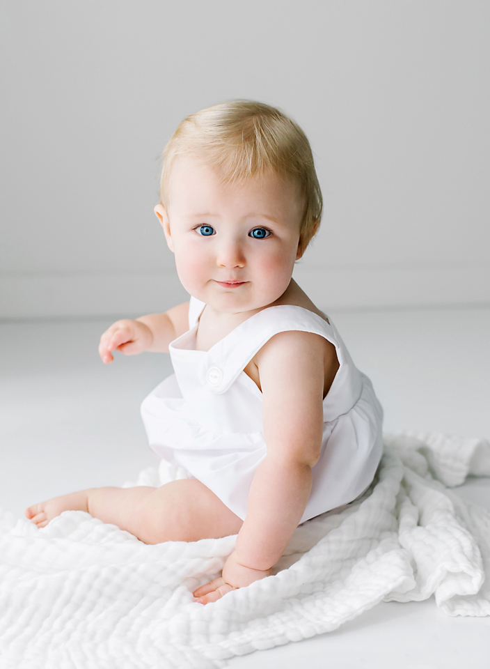 jackson ms one year old photo shoot baby boy sitting on white blanket