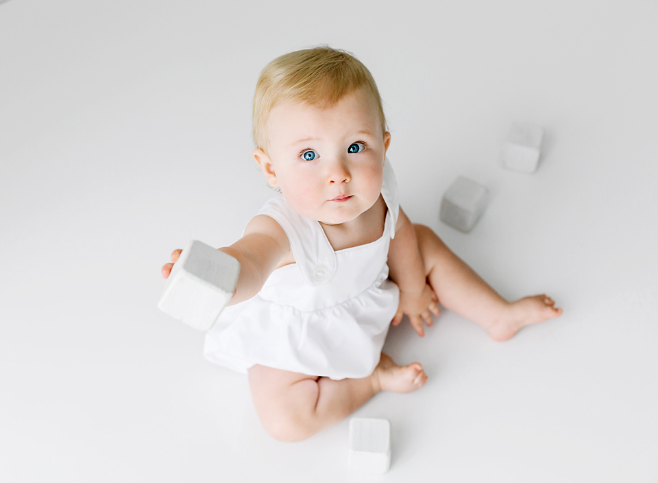 meridian ms child photography baby sitting on floor playing with blocks photo shoot