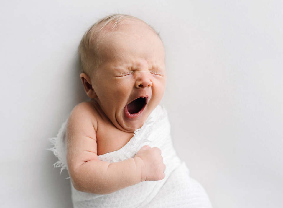 meridian ms modern baby photographer baby yawning